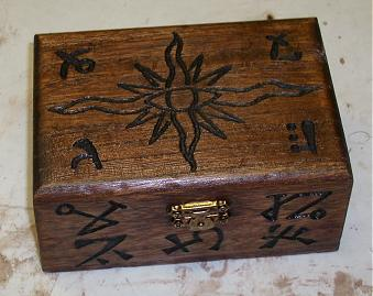 A prop carved wooden box with Lovecraftian sigils. Contained a bottle of mysterious green liquid.  (sold)