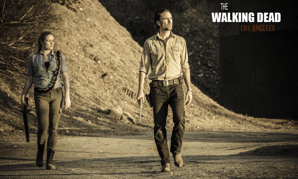 Rick and Andrea heading down a remote road, watching for Walkers.