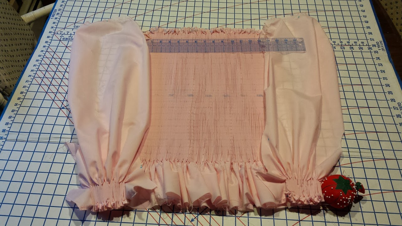 The dress bodice and sleeve wrists ready to be smocked (embroidered).