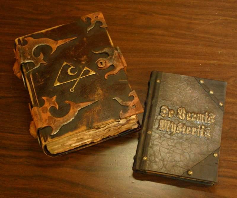 Two pro tomes, The Necronomicon and De Vermis Mysteriis